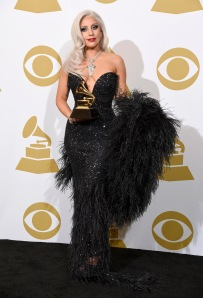"Lady Gaga poses in the press room with the award for best traditional pop vocal album for ""Cheek to Cheek"" at the 57th annual Grammy Awards at the Staples Center on Sunday, Feb. 8, 2015, in Los Angeles. (Photo by Chris Pizzello/Invision/AP)"