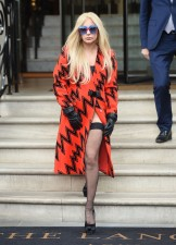 51917487 Singer Lady Gaga leaves the Langham Hotel in London, England on November 25, 2015. The 'Poker Face' singer showed off her eccentric fashion sense in a knee-length orange coat with a zig-zag pattern, sheer black stockings, platform black shoes and black leather gloves. FameFlynet, Inc - Beverly Hills, CA, USA - +1 (818) 307-4813 RESTRICTIONS APPLY: USA/CHINA ONLY